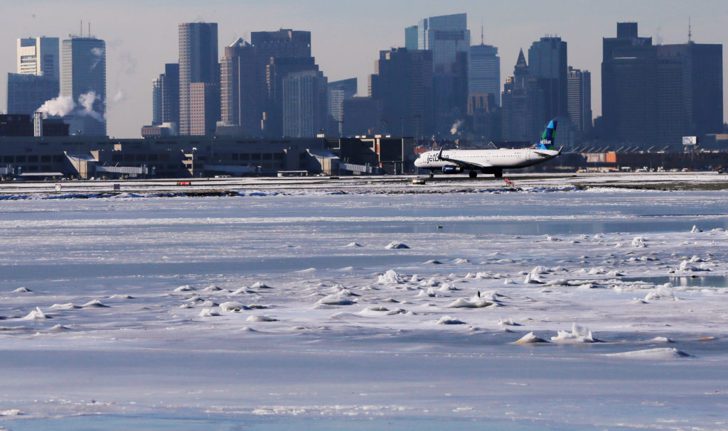 Ahead of an incoming winter snow storm, a Jet Blue flight waits to …