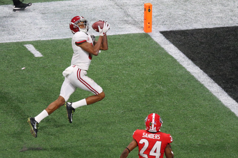 Jan 8, 2018; Atlanta, GA, USA; Alabama Crimson Tide wide receiver DeVonta Smith (6) catches the game-winning touchdown during overtime against the Georgia Bulldogs in the 2018 CFP national championship college football game at Mercedes-Benz Stadium. Mandatory Credit: Butch Dill-USA TODAY Sports - 10532681