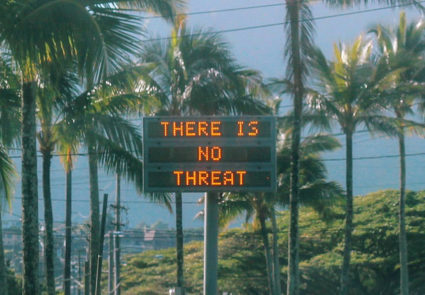 "An electronic sign reads ""There is no threat"" in Oahu, Hawaii, U.S., after a false emergency alert that said a ballistic missile was headed for Hawaii, in this Jan. 13, 2018, photo obtained from social media. Photo courtesy of @sighpoutshrug on Instagram via Reuters"