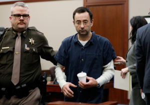 Dr. Larry Nassar, a former team USA Gymnastics doctor who pleaded guilty in November 2017 to sexual assault charges, is escorted by a court officer during his sentencing hearing in Lansing, Michigan, U.S., January 16, 2018. Photo by Brendan McDermid/Reuters