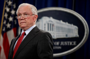 "Attorney General Jeff Sessions stands during a 2017 news conference to discuss ""efforts to reduce violent crime"" at the Department of Justice in Washington, D.C. Photo by Joshua Roberts/Reuters"