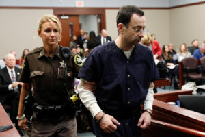 Larry Nassar, a former team USA Gymnastics doctor, who pleaded guilty in November 2017 to sexual assault charges, returns from a break to listen to victim testimony in the courtroom during his sentencing hearing in Lansing, Michigan, U.S., January 23, 2018. REUTERS/Brendan McDermid - RC183F7488C0