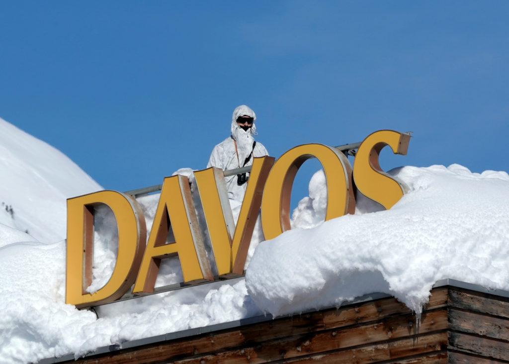 A Swiss special police officer stands guard atop the Davos Congress Hotel during the World Economic Forum's annual meeting on Jan. 24. Photo by Denis Balibouse/Reuters
