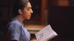 Poet Rupi Kaur reads her poems from the stage of the Rose Theatre in Brampton, Canada. Credit: Jaywon Choe