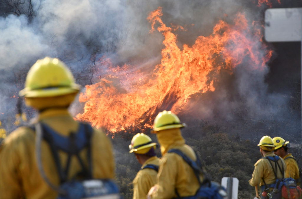 Fire fighters attack the Thomas Fire near Ojai