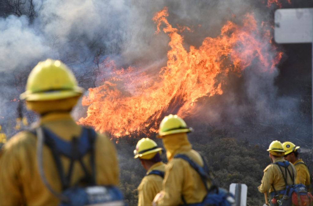 Fire fighters attack the Thomas Fire near Ojai