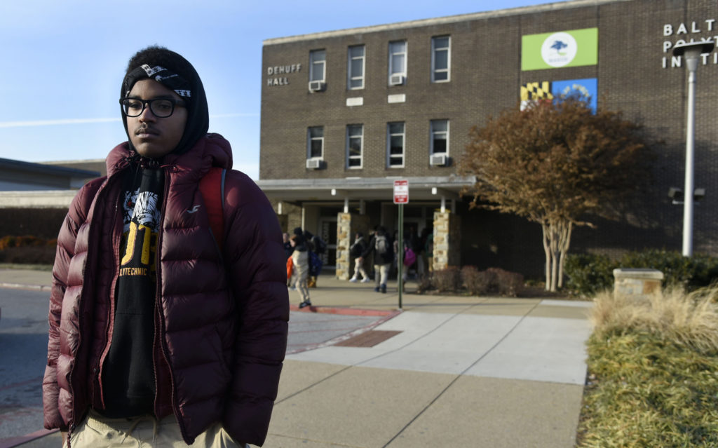 Matthew Cunningham, 18, a senior at Baltimore Polytechnic Institute, talks about the cold temperatures in the school as he leaves for the day on Jan. 3. Another Baltimore City school, Frederick Douglass High School, closed early due to the cold. Photo by Kim Hairston/Baltimore Sun/TNS via Getty Images