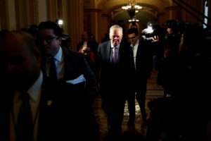 U.S. Senate Majority Leader Chuck Schumer (D-NY) arrives to meet with newly-sworn in U.S. Senator Doug Jones (D-AL) and Senator Tina Smith (D-MN) in his office at the U.S. Capitol in Washington, U.S. January 3, 2018. REUTERS/Jonathan Ernst - RC1F448D4C10