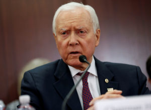 "Chairman of the Senate Budget Committee Orrin Hatch (R-UT) speaks at the start of the House-Senate Conferees conference meeting on the ""Tax Cuts and Jobs Act"" on Capitol Hill in Washington, U.S., December 13, 2017. REUTERS/Joshua Roberts - RC131011E000"