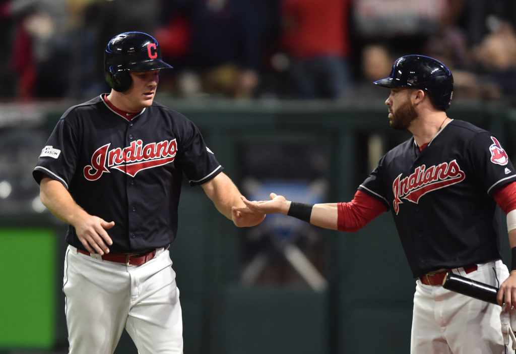 Oct 11, 2017; Cleveland, OH, USA; Cleveland Indians right fielder Jay Bruce (32) celebrates with second baseman Jason Kipnis (22) after scoring during the fifth inning of game five of the 2017 ALDS playoff baseball series against the New York Yankees at Progressive Field. Mandatory Credit: Ken Blaze-USA TODAY Sports - 10341296