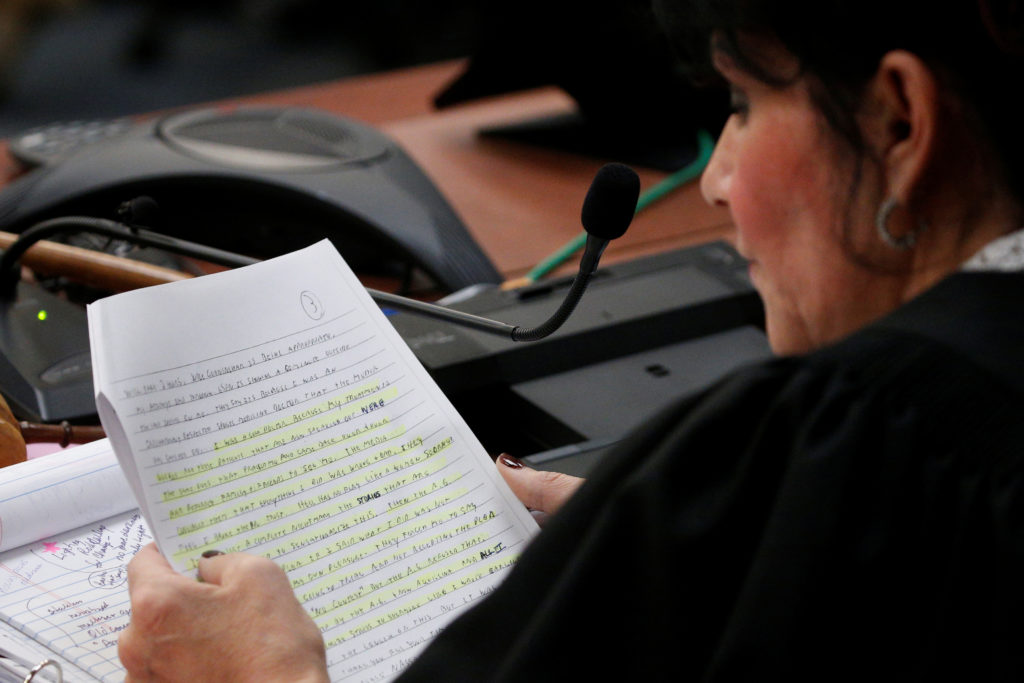 Circuit Court Judge Rosemarie Aquilina reads a portion of a letter from Larry Nassar, a former team USA Gymnastics doctor who pleaded guilty in November 2017 to sexual assault charges, during his sentencing hearing in Lansing, Michigan, U.S., January 24, 2018. REUTERS/Brendan McDermid - RC1EEC645250