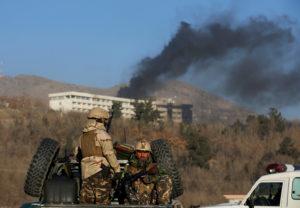 Afghan security forces keep watch as smoke rises from the Intercontinental Hotel in Kabul,ÊAfghanistanÊJanuary 21, 2018. REUTERS/Omar Sobhani - RC1B2DA9DB20