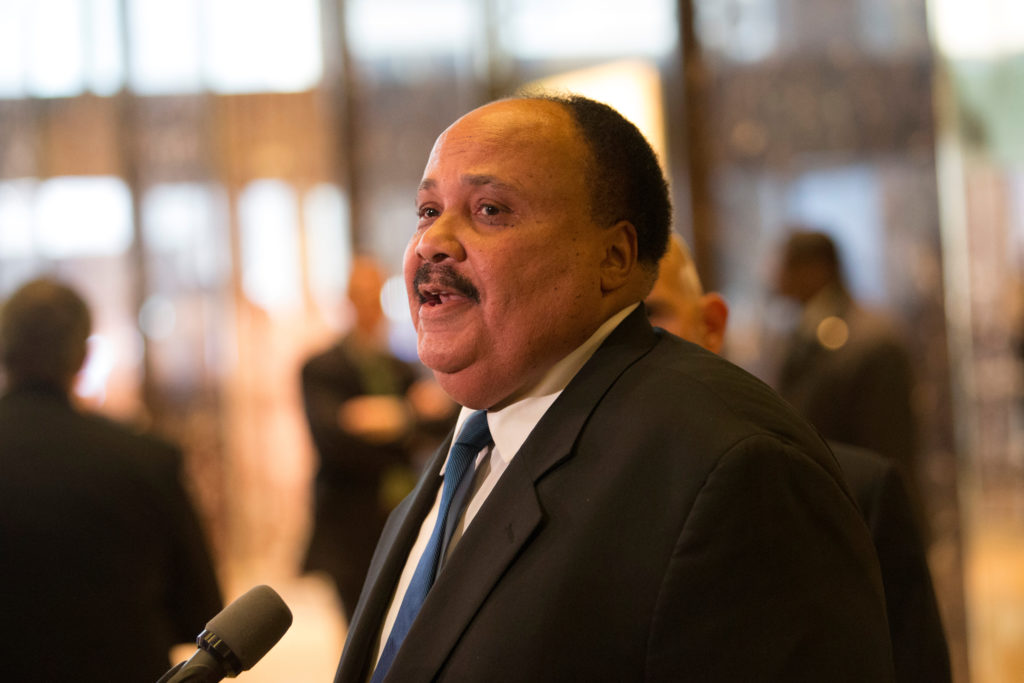 Martin Luther King III (center), an American human rights advocate, speaks to the press after meeting with U.S. President-elect Donald Trump, at Trump Tower in Manhattan, New York City, U.S., January 16, 2017. REUTERS/Alex Wroblewski - RC17963381D0