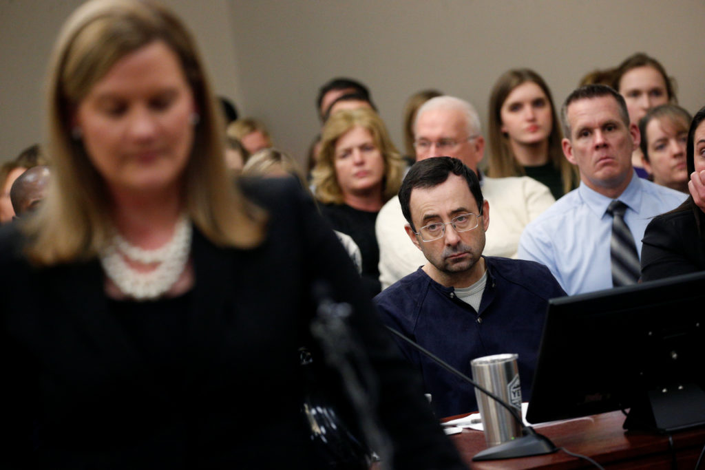 Prosecutor Angela Povilaitis speaks at the sentencing hearing for Larry Nassar, a former team USA Gymnastics doctor who pleaded guilty in November 2017 to sexual assault charges, in Lansing, Michigan, U.S., January 24, 2018. REUTERS/Brendan McDermid - RC1C69A9EF90
