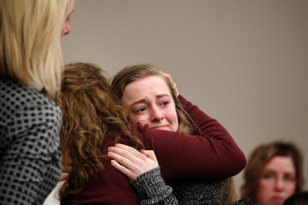 Victim Brooke Hylek is hugged by family members after speaking at the sentencing hearing for Larry Nassar, a former team U...