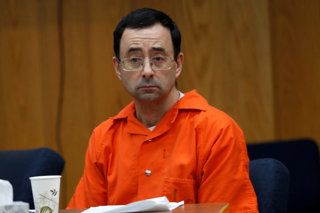 Larry Nassar, a former team USA Gymnastics doctor who pleaded guilty in November 2017 to sexual assault, listens to victims impact statements during his sentencing in the Eaton County Circuit Court in Charlotte, Michigan. Photo by Rebecca Cook/Reuters
