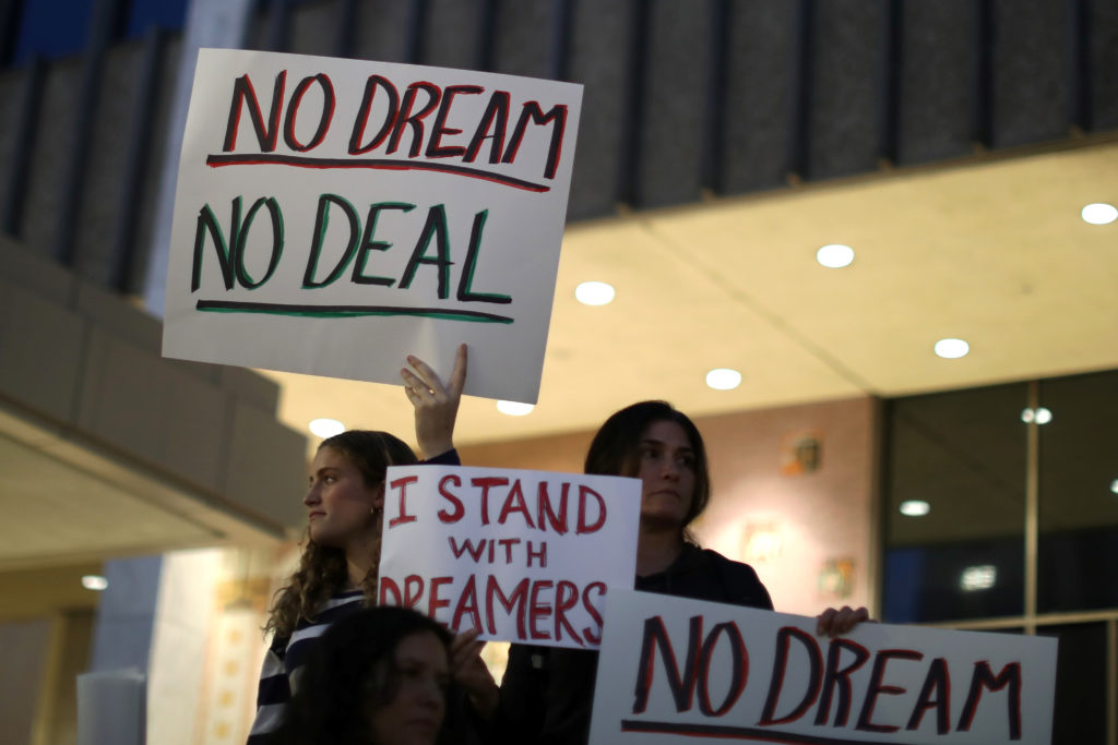 People protest to call for a new DREAM Act to replace DACA in Los Angeles, California U.S. January 17, 2018. REUTERS/Lucy Nicholson - RC1A8E5BBF30
