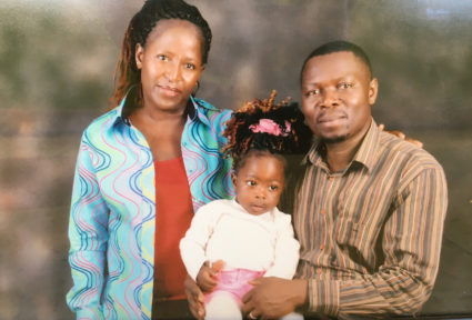 Photograph of Sarah Omega, her husband Kennedy Otieno and their daughter, Jade