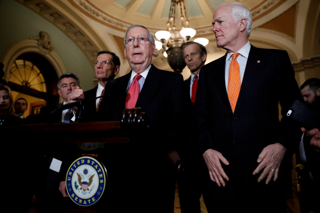 Senate Majority Leader Mitch McConnell, accompanied by Sen. John Cornyn (R-TX), Sen. John Thune (R-SD), Sen. John Barrasso (R-WY) and Sen. Cory Gardner (R-CO), speaks with reporters following the party luncheons on Capitol Hill in Washington, U.S. January 23, 2018. REUTERS/Aaron P. Bernstein - RC1DA734D0E0