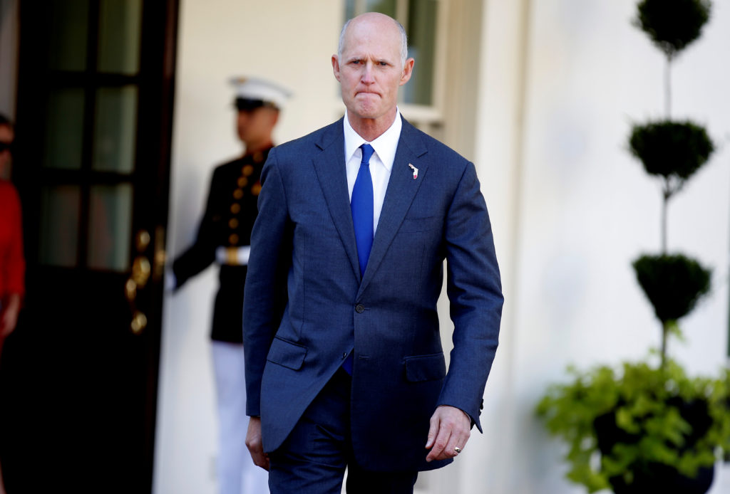 Florida Governor Rick Scott arrives to speak about hurricane relief measures for Florida and Puerto Rico at the White House in Washington, U.S., September 29, 2017. REUTERS/Joshua Roberts - RC1DB00C0860