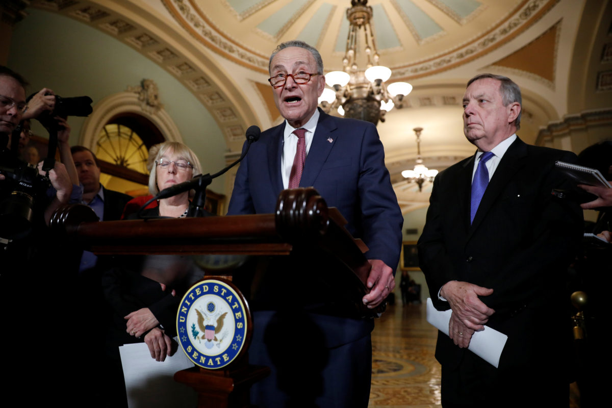 Senate Minority Leader Chuck Schumer, accompanied by Sen. Dick Durbin (D-IL) and Sen. Patty Murray (D-WA), speaks with reporters following the party luncheons on Capitol Hill in Washington, U.S. January 23, 2018. REUTERS/Aaron P. Bernstein - RC1438BB9D80