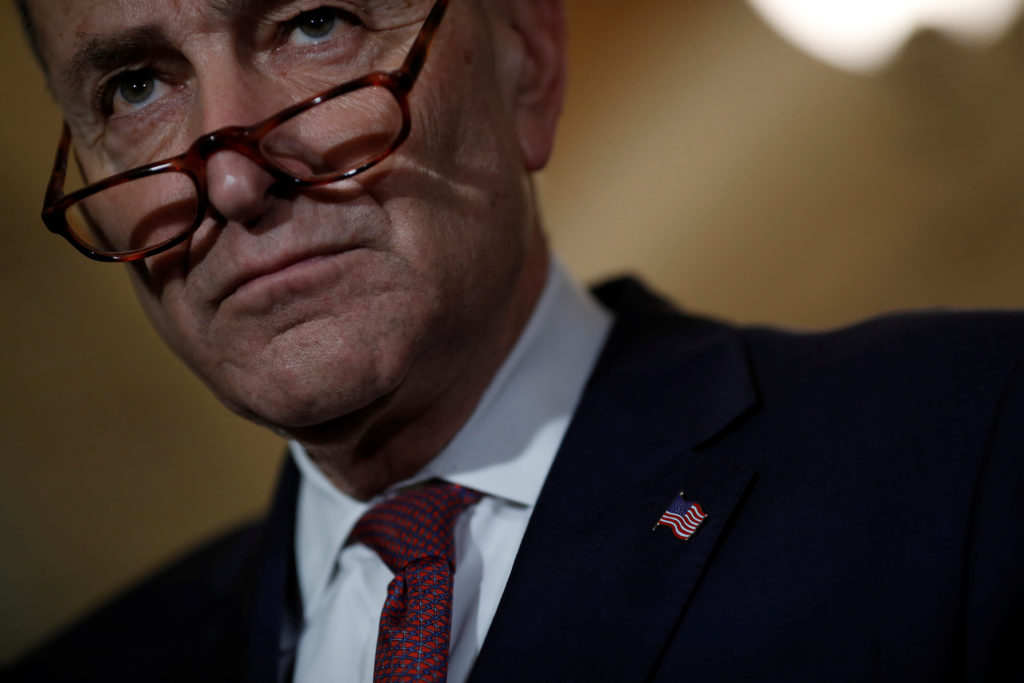 Senate Minority Leader Chuck Schumer speaks with reporters followin…