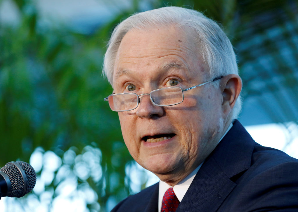 FILE PHOTO: U.S. Attorney General Jeff Sessions speaks on the growing trend of violent crime in sanctuary cities during an event on the Port of Miami in Miami, Florida, U.S. on, August 16, 2017. REUTERS/Joe Skipper/File Photo - RC140CCB1430