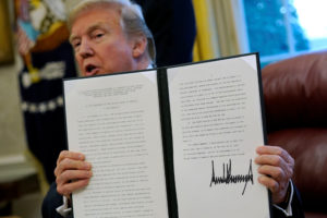 U.S. President Donald Trump speaks to reporters after signing directives to impose tariffs on imported washing machines and solar panels before signing it in the Oval Office at the White House in Washington, U.S. January 23, 2018. REUTERS/Jonathan Ernst - RC1542E59120