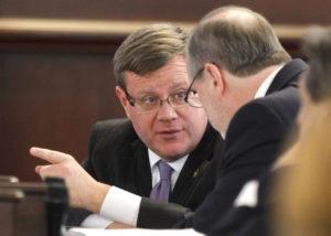 North Carolina Speaker of the House Tim Moore, left, confers with President Pro Tempore Phil Berger in the Senate chambers during a special session of the North Carolina General Assembly on Friday, Dec. 16, 2016 at the Legislative Building in Raleigh, N.C. (Ethan Hyman/Raleigh News & Observer/TNS via Getty Images)