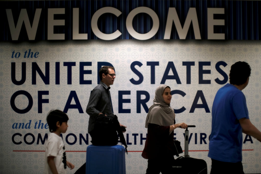 FILE PHOTO: International passengers arrive at Washington Dulles International Airport after the U.S. Supreme Court granted parts of the Trump administration's emergency request to put its travel ban into effect later in the week pending further judicial review, in Dulles, Virginia, U.S., June 26, 2017. REUTERS/James Lawler Duggan/Files - RC1526C4F2E0