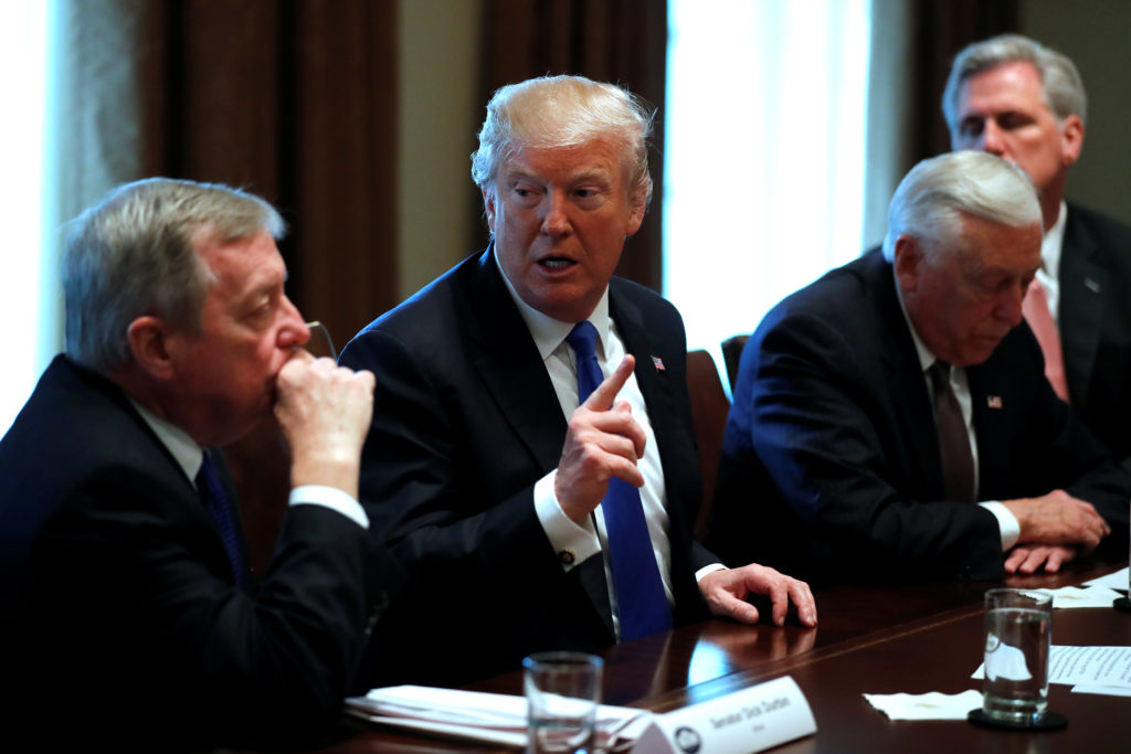 U.S. President Donald Trump, flanked by U.S. Senator Dick Durbin (D-IL), Representative Steny Hoyer (D-MD) and House Majority Leader Kevin McCarthy (R-CA), holds a bipartisan meeting with legislators on immigration reform at the White House in Washington, U.S. January 9, 2018. REUTERS/Jonathan Ernst - RC1ADD70FE50
