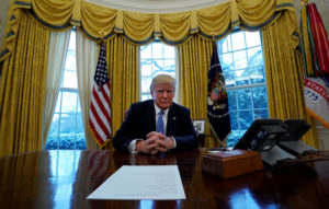 U.S. President Donald Trump sits at the Resolute Desk during an interview with Reuters at the White House in Washington, U.S., January 17, 2018. REUTERS/Kevin Lamarque - RC1D31F759A0
