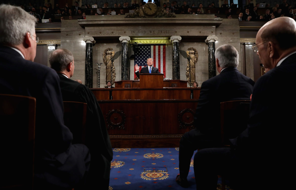 U.S. President Donald Trump delivers his first State of the Union address to a joint session of Congress inside the House Chamber on Capitol Hill in Washington, U.S., January 30, 2018. REUTERS/Win McNamee/Pool - HP1EE1V0BTW2T