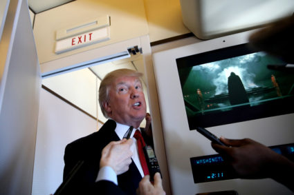 "U.S. President Donald Trump talks to journalists, members of the travel pool, on board Air Force One during his trip to Palm Beach, Florida, U.S., April 6, 2017. Carlos Barria: ""During the many trips to President Trump's residence in Florida it is usual to see the president coming to the back of the plane to chat with journalists. During one of the trips to the so called 'Winter White House', Trump had a long talk with reporters while the Air Force One entertainment system was playing one of the latest Star Wars movies. As I was listening to Trump talk I was also looking at the movie waiting for a part of the movie to frame the mood of the day. Of the many scenes, I choose the one with Darth Vader."" REUTERS/Carlos Barria/File Photo SEARCH ""POY TRUMP"" FOR THIS STORY. SEARCH ""REUTERS POY"" FOR ALL BEST OF 2017 PACKAGES. TPX IMAGES OF THE DAY FOR EDITORIAL USE ONLY. NO RESALES. NO ARCHIVES - RC173AD44C00 - RC19120B8D50"