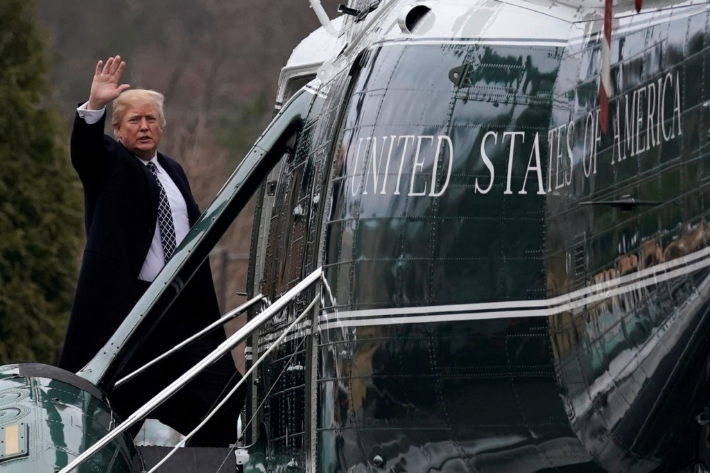 U.S. President Donald Trump waves from the steps of Marine One helicopter upon his departure after his annual physical exam at Walter Reed National Military Medical Center in Bethesda, Maryland, U.S., January 12, 2018. REUTERS/Yuri Gripas - RC1DC03C7220