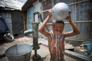 A child washes himself in Kallyanpur, a neighborhood in Bangladesh's capital, Dhaka. U.N. photo by Kibae Park