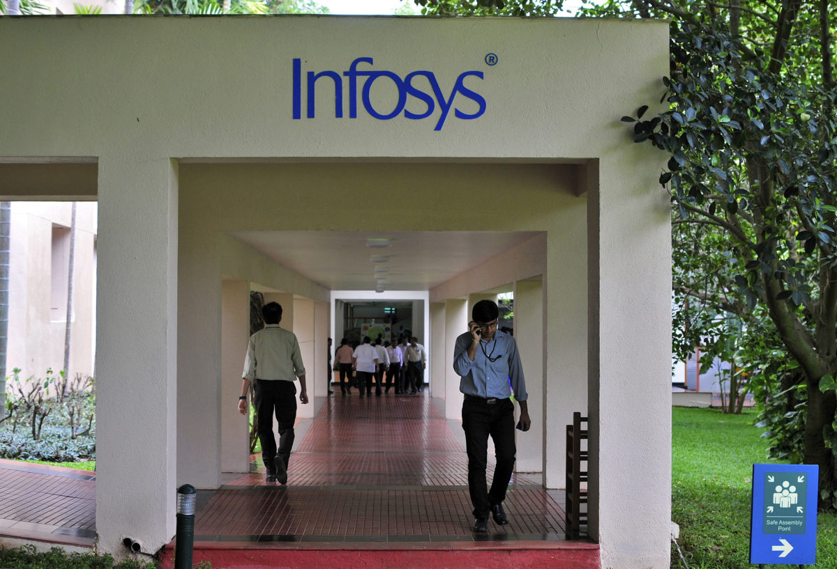 Employees walk along a corridor in the Infosys campus in the southern Indian city of Bangalore September 23, 2014. Infosys Ltd's new CEO Vishal Sikka has come up with a novel approach to reviving the financial fortunes of India's trailblazing outsourcing firm: use Facebook at work, tweet, but get the job done. Infosys has long been run as a conservative company known for keeping strict tabs on work hours and sometimes fining employees for not wearing ties on specific days. Such cheerless self-regard could not have come at a more challenging time, analysts say. To retain talent, Sikka hopes to create a more employee-friendly workplace. To match story INFOSYS-CEO/STRATEGY REUTERS/Abhishek Chinnappa (INDIA - Tags: BUSINESS SCIENCE TECHNOLOGY EMPLOYMENT) - GM1EA9O0EM601