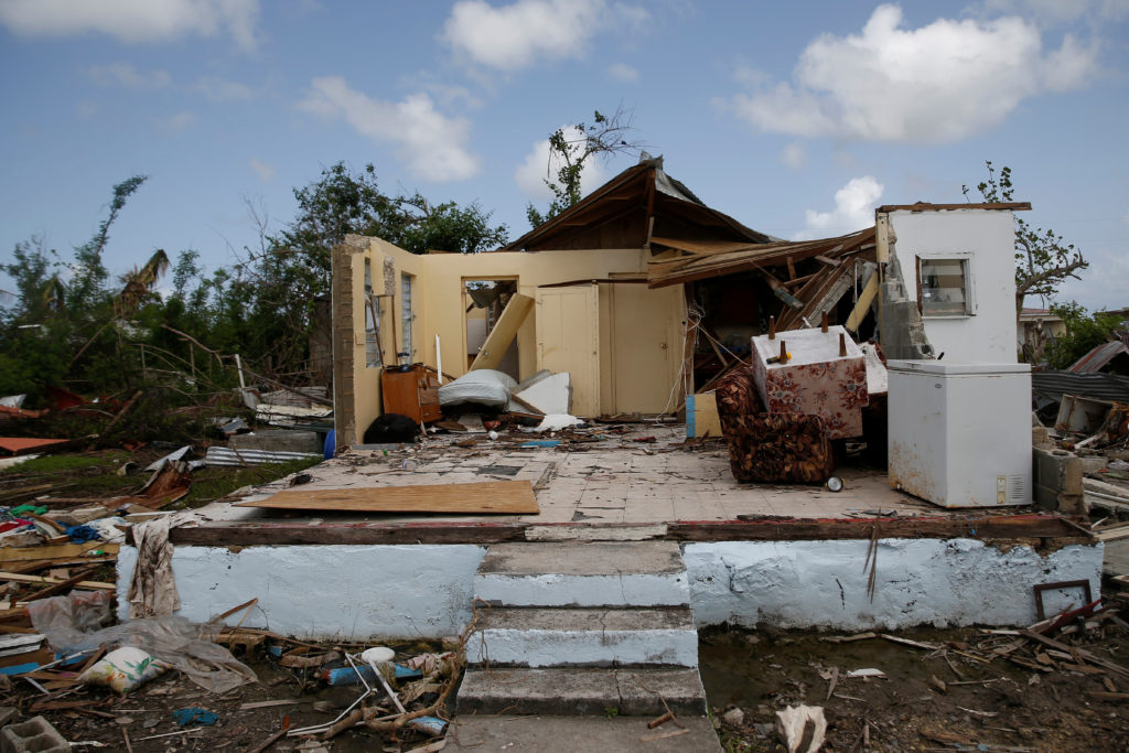 A damaged home on the island of Barbuda seen in October 2017, a month after Hurricane Irma struck the Caribbean islands of Antigua and Barbuda. Photo by Shannon Stapleton/Reuters
