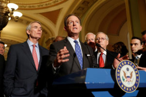 Sen. Pat Toomey (R-PA), accompanied by Sen. Rob Portman (R-OH) and Senate Majority Leader Mitch McConnell, speaks with reporters following the party luncheons on Capitol Hill in Washington, U.S. November 14, 2017. REUTERS/Aaron P. Bernstein - RC1317588840