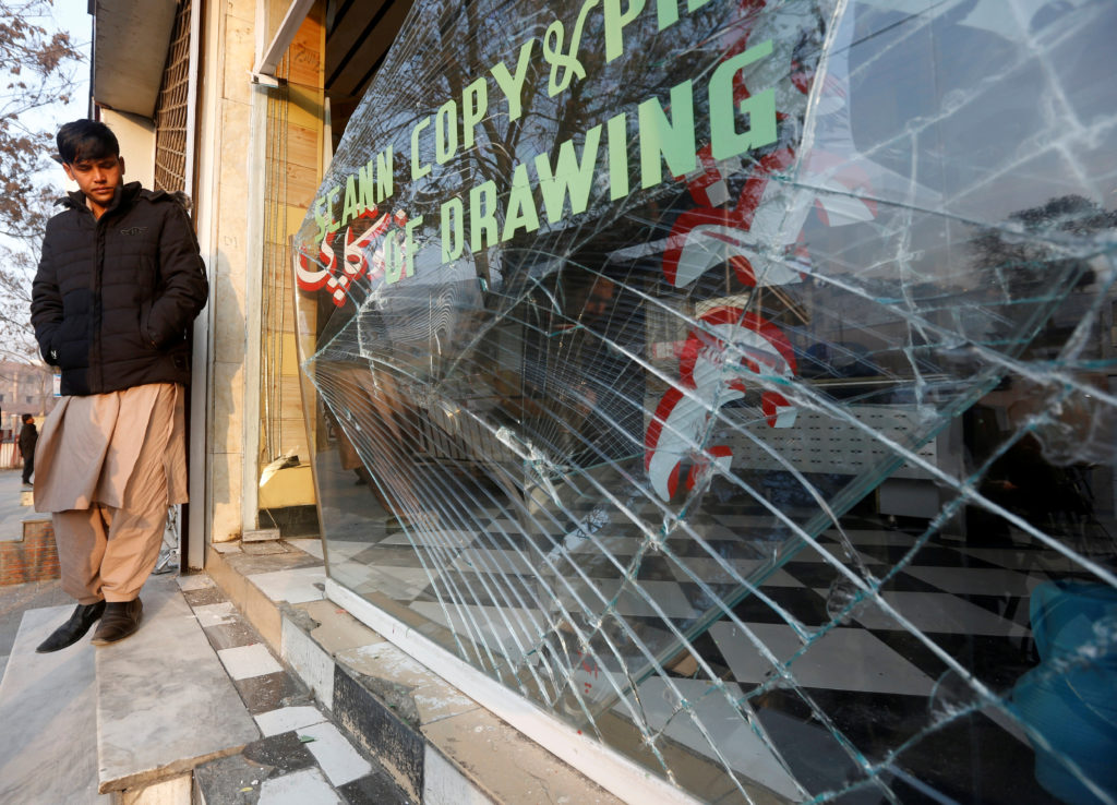 An Afghan shopkeeper surveys the damages caused by a bomb attack in Kabul on Jan. 28. Photo by Omar Sobhani/Reuters