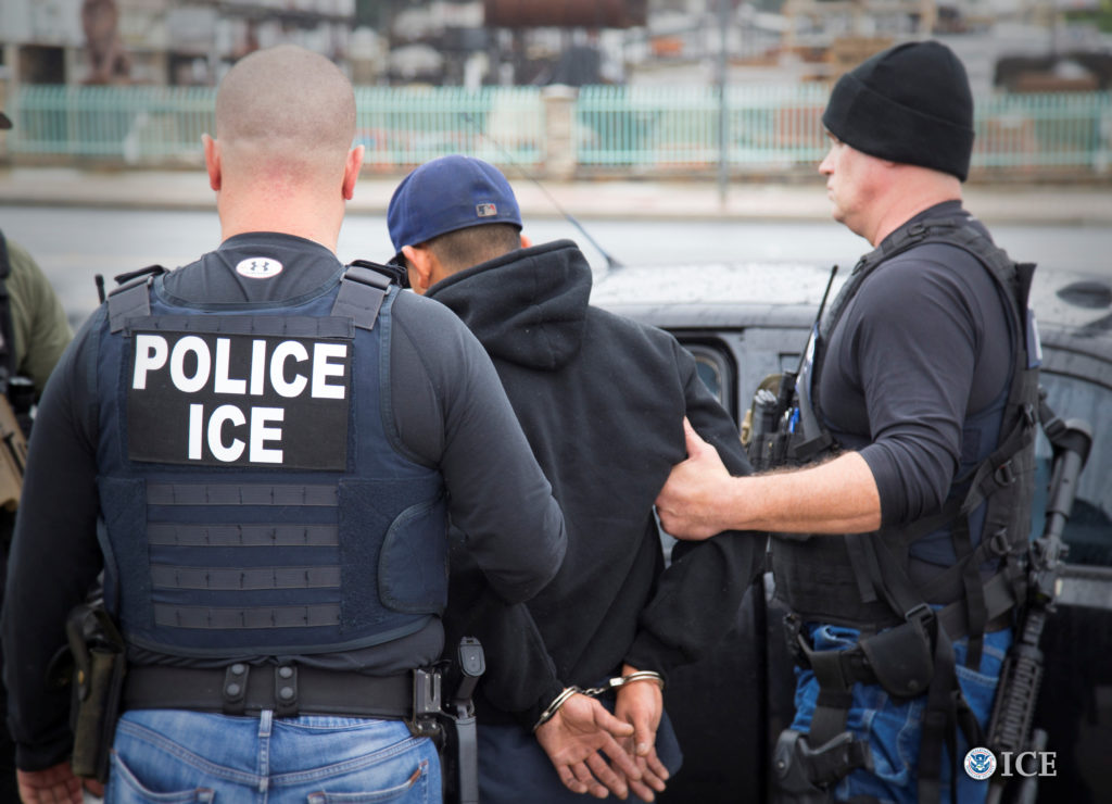 Immigration and Customs Enforcement (ICE) officers detain a suspect as they conduct a targeted enforcement operation in Los Angeles on Feb. 7, 2017. Photo courtesy Charles Reed/U.S. Immigration and Customs Enforcement via Reuters