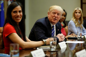 U.S. President Donald Trump (C), flanked by Trumbull Unmanned CEO Dyan Gibbens (L), Johnson Security Bureau President Jessica Johnson (2nd R) and Ivanka Trump (R), meets with women small business owners at the White House in Washington, U.S., March 27, 2017. REUTERS/Jonathan Ernst - RC1C831FA580