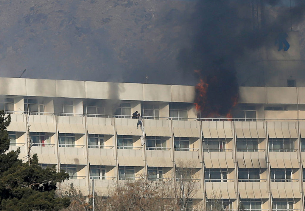 A man tries to escape from a balcony at Kabul's Intercontinental Hotel on Jan. 21 during an attack by gunmen in Afghanistan. Photo by Omar Sobhani/Reuters