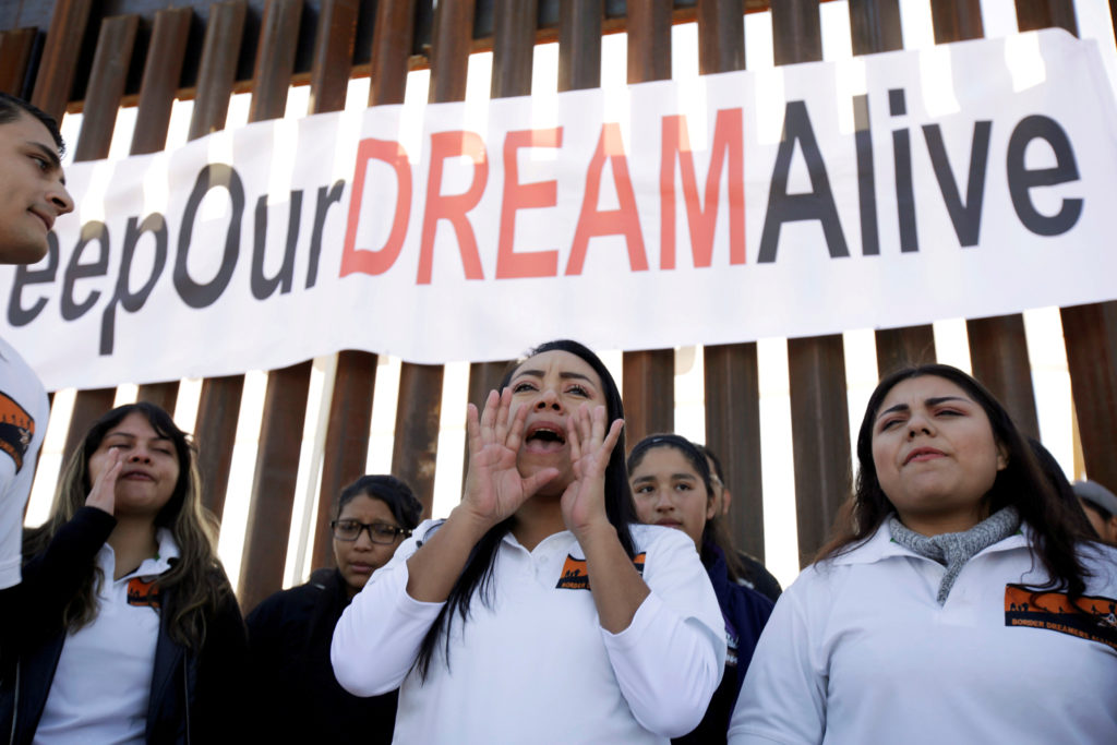 'Dreamers' react as they meet with relatives during the 'Keep Our Dream Alive' binational meeting at a new section of the ...