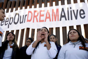 'Dreamers' react as they meet with relatives during the 'Keep Our Dream Alive' binational meeting at a new section of the border wall on the U.S.-Mexico border in Sunland Park in December. Photo by Jose Luis Gonzalez/Reuters