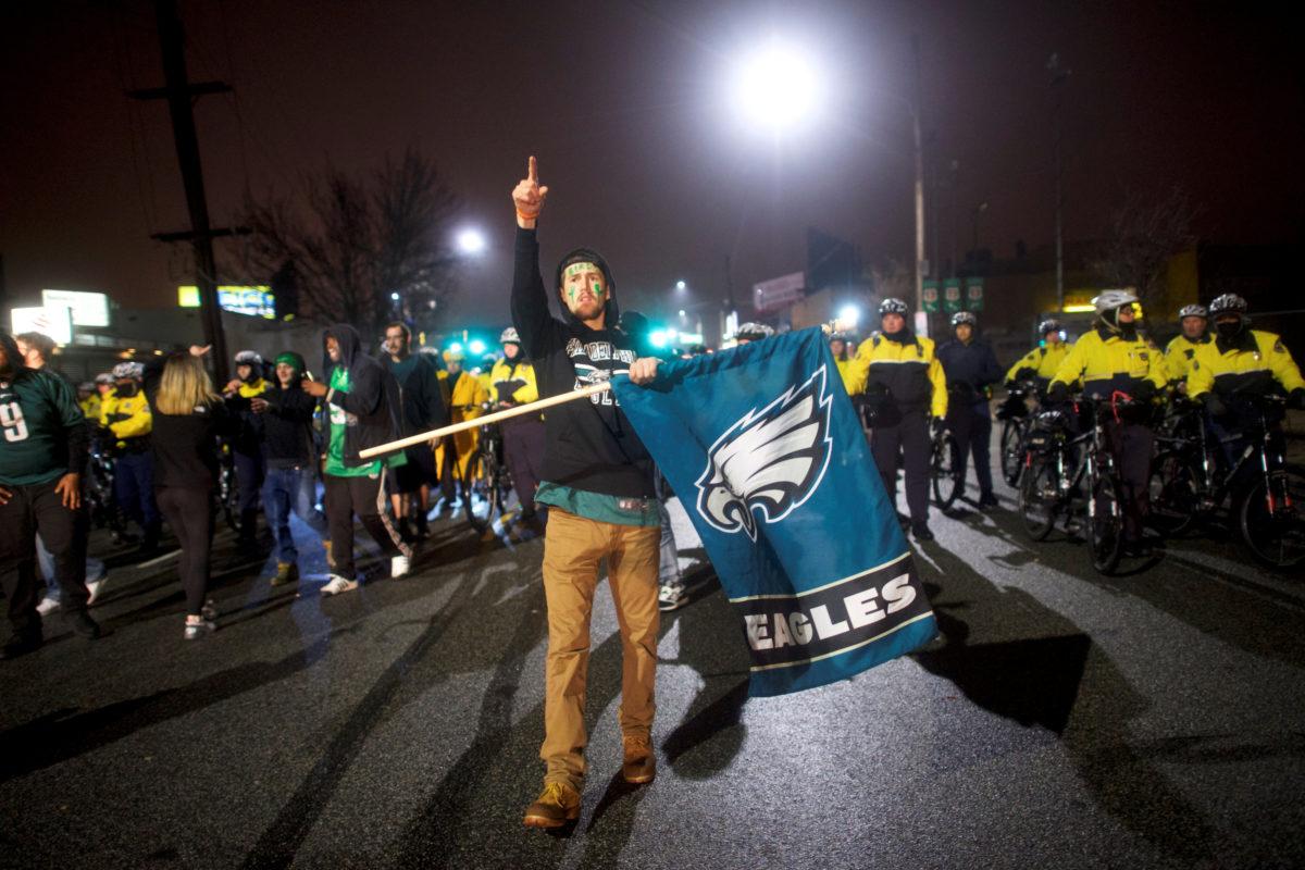 Tom Roush waves a flag while celebrating the Philadelphia Eagles Superbowl LII victory over the New England Patriots in Philadelphia, Pennsylvania U.S. February 5, 2018. REUTERS/Mark Makela