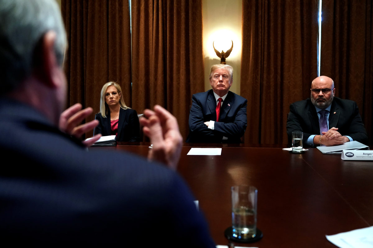 President Donald Trump, flanked by Secretary of Homeland Security Kirstjen Nielsen (L) and Immigration and Customs Enforcement (ICE) Homeland Security Investigations Special Agent In Charge for New York City Angel Melendez (R), meets with members of Congress and law enforcement about crime and immigration issues, specifically the MS-13 gang, at the White House. Photo by Jonathan Ernst/Reuters