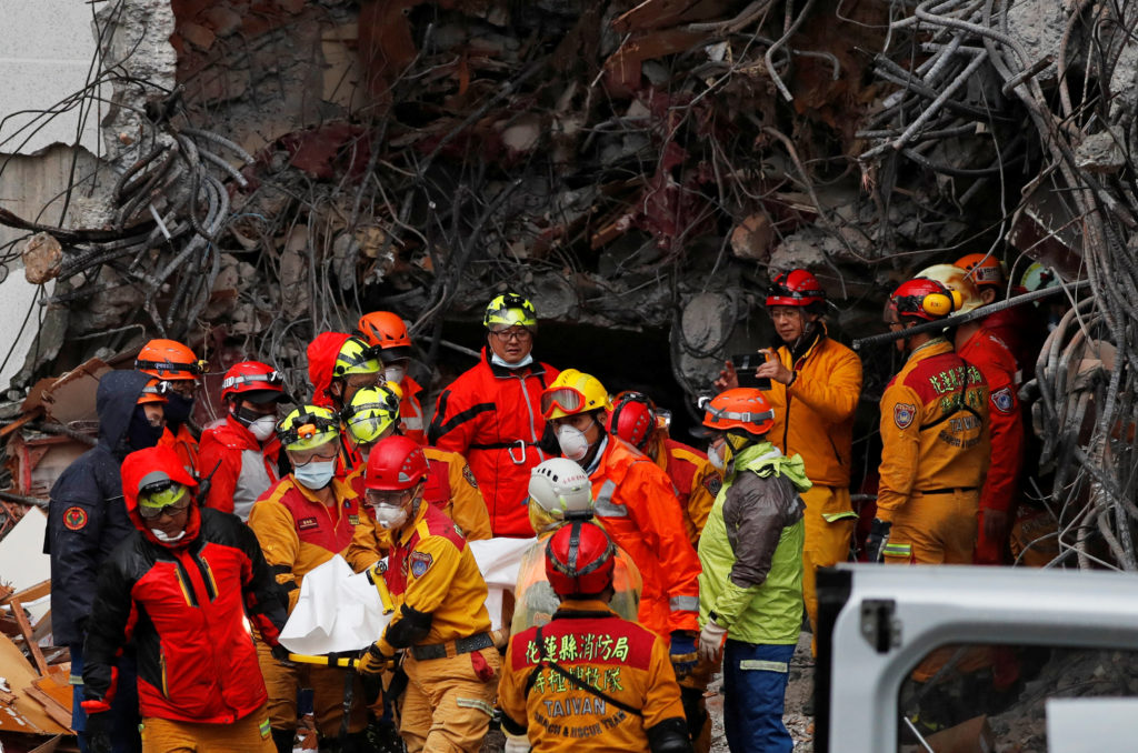 A body of employee of collapsed Marshal Hotel carried by a rescue personnel after an earthquake hit Hualien, Taiwan. Photo by Tyrone Siu/Reuters