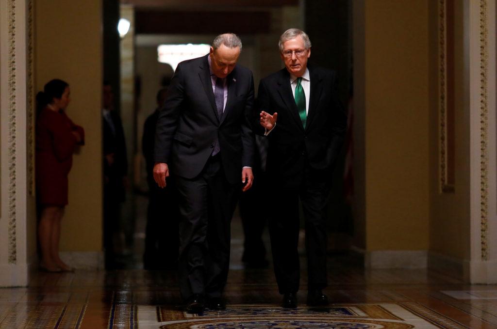 U.S. Senate Minority Leader Chuck Schumer (D-NY) and U.S. Senate Majority Leader Mitch McConnell (R-KY) walk to the Senate...