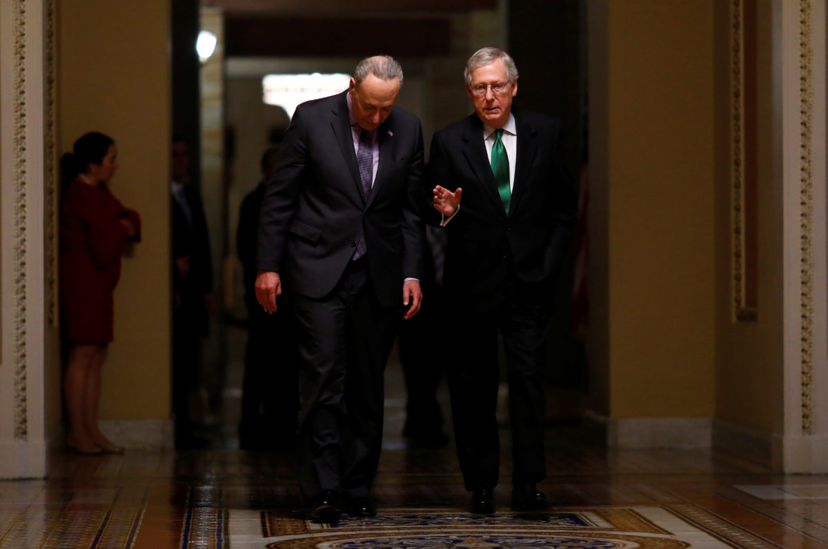 U.S. Senate Minority Leader Chuck Schumer (D-NY) and U.S. Senate Majority Leader Mitch McConnell (R-KY) walk to the Senate chamber on Capitol Hill in Washington, D.C., U.S., February 7, 2018. REUTERS/Eric Thayer - RC1FA5A1A240